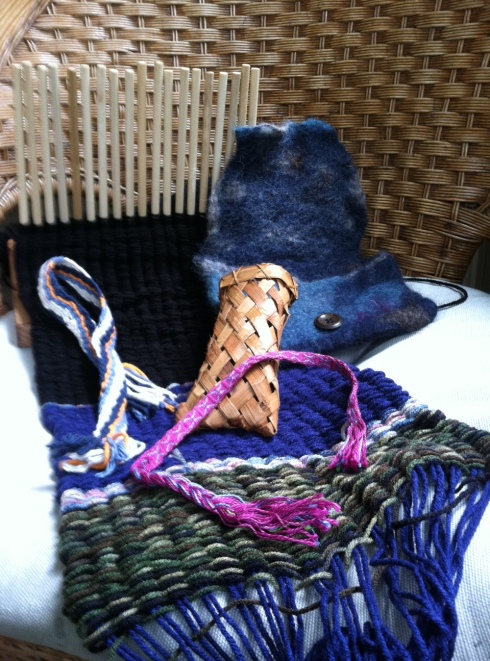 This is what I made at Traditional Ways! Still under construction: peg weaving scarf. Finished: random strip of cloth I made via fingerweaving. Bracelet made doing tablet weaving. Cedar bark teeny basket/pouch I will use for eyeglasses. Felted wool pouch.